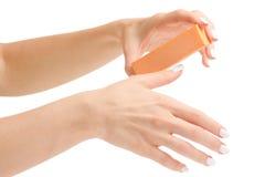 Female hand manicure nail buff. On white background isolation Stock Images