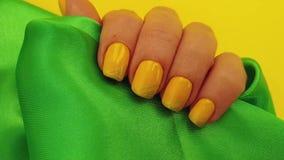Female hand, manicure, silk fabric, slow motion stock video