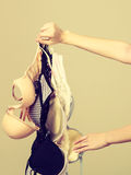 Female hand with many bras to wear Royalty Free Stock Image