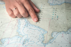 Female hand on the map Royalty Free Stock Image