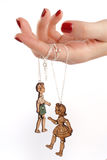 Female hand marionette jewelery Stock Image