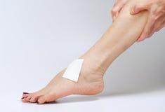 Female hand massages her leg Royalty Free Stock Image