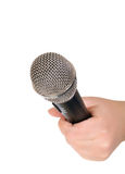 Female hand with a microphone. Stock Photos