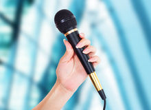 Female Hand with microphone Royalty Free Stock Photo