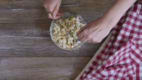 Female hand mixed salad with two tablespoons. Top view stock video footage
