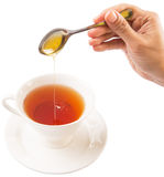 Female Hand Mixing Honey With Tea V Royalty Free Stock Image