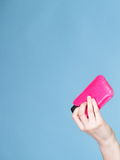 Female hand with mobile phone in pink cover Royalty Free Stock Photos