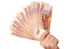Female hand with money. Female hand with russian money (roubles royalty free stock photo