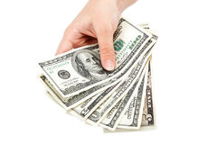 Female hand with money isolated on a white. Stock Image
