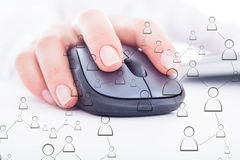 Female hand on the mouse Stock Image