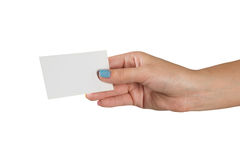 Female hand with multicolored manicure holding a blank business card isolated on white background Stock Photo
