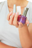 Female hand with nail varnish bottles Stock Photo