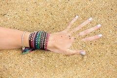 Female hand in the ocean Stock Photos