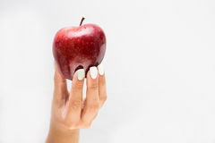 Female Hand Offering a tasty Apple Stock Photography