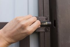 Female hand open or close metal latch lock royalty free stock images