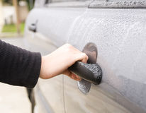 Female hand Opening Car Door Stock Photo