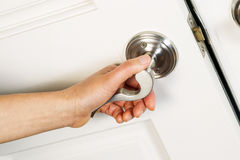 Female Hand Opening Front Door Royalty Free Stock Image