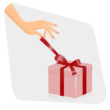 Female hand opening gift Royalty Free Stock Photography