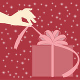 Female hand opening the gift Stock Photos