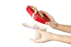 Female hand opening gift box Stock Images