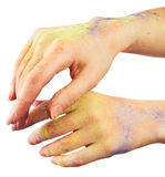Female hand in paint Royalty Free Stock Image