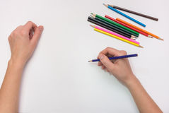 Female hand painted with colored pencils paper, close-up Stock Photo