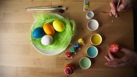 Female Hand Painted Easter Eggs with a Brush stock footage