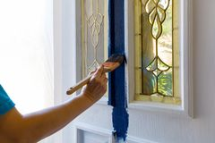 Free Female Hand Painting House Front Door Stock Image - 117737311
