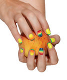 Female hand with a peach Stock Photo