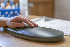 Female hand on a pedicure table stock photo