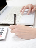 Female hand with pen, notebook and calculator at desktop Stock Photography