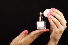 Female hand with perfume bottle black background Royalty Free Stock Photos