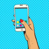 Female hand with phone pop art vector royalty free illustration