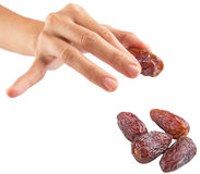 Female Hand Picking Date Fruits II Stock Photos