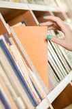 Female hand picking a right book Stock Photography