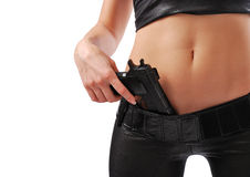 Female hand with pistol and sexy body. Stock Photo