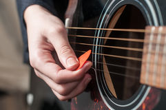 Female hand playing acoustic guitar Royalty Free Stock Image