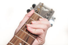 Female hand playing acoustic guitar Stock Photo