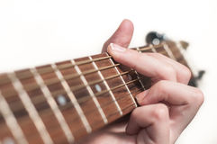 Female hand playing acoustic guitar Royalty Free Stock Images