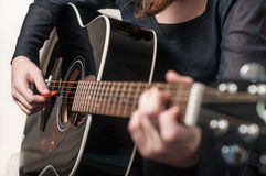 Female hand playing acoustic guitar Royalty Free Stock Photo