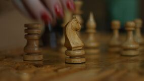 Female hand playing chess game and making a move stock video footage