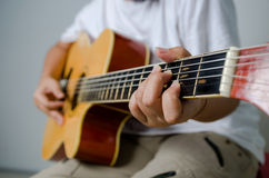 Female hand playing music by acoustic guitar - Close up shot and Stock Photography