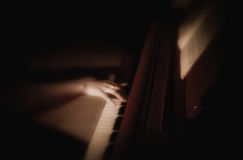 Female hand playing the piano. Notes. Royalty Free Stock Photography