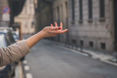 Female hand pointing in the city streets Stock Photo