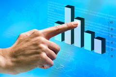 Female hand pointing at financial graphic. Female hand pointing at financial graphic in futuristic interface Stock Photos