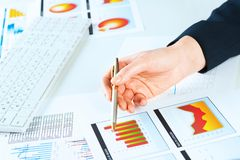 Female hand pointing to the financial growth chart Stock Photo