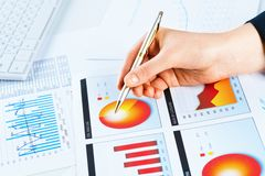 Female hand pointing to the financial growth chart Royalty Free Stock Photo