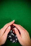 Female hand and poker chips Stock Photos