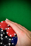 Female hand and poker chips Stock Photography