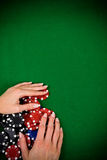 Female hand and poker chips Stock Image